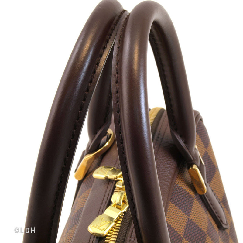 Louis Vuitton Triana ( Authentic Pre Owned)