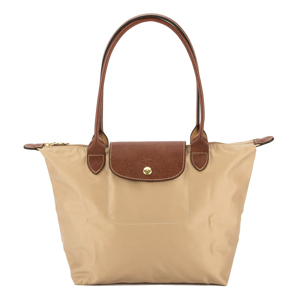 deb626aba3b Previously sold at Bloomingdales · Womens Longchamp Neo  reputable site  4b9e4 2ebca Longchamp Beige Nylon Canvas Le Pliage Small Tote Bag (New with  ...