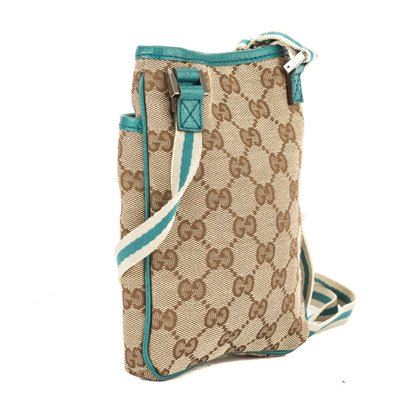 a8316e474c8c9c +; Gucci Teal Leather GG Monogram Canvas Mini Travel Messenger Bag (Pre  Owned)
