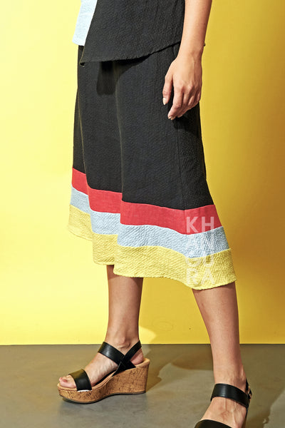 Fashionable and trendy natural fiber pull-on skirt by Khangura. Beautiful black skirt with multi color border. Boutique fashion skirt.