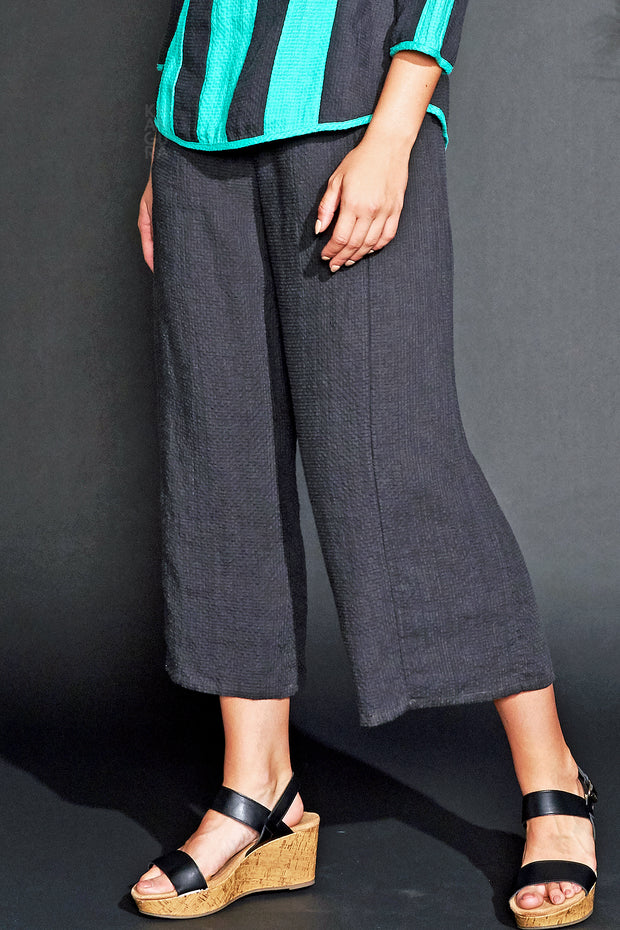 Khangura straight panel pants with pockets. Black linen capri pants perfect for the season. Comfy clothing USA made by Khangura Online Boutique.