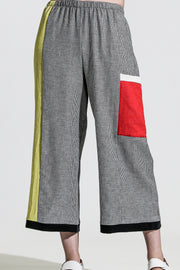 Khangura Artful Palazzo pants with contrast patch pocket. Comfortable and Edgy clothing by Khangura. Classy Designer Clothing by Khangura. High-end Capri Pants. Colorful and Funky Pants.