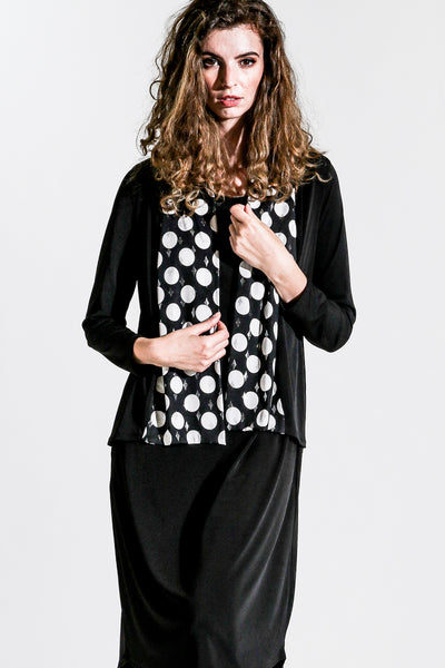 Sophisticated outfit with crop jacket by Khangura. comfortable soft and supple ladies jacket, great for travelling. upscale women's cardigan jacket. Soft jersey knit black white polka dot accent long sleeve short crop jacket.