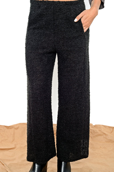 Khangura straight panel pants in Black Bouclé by Shop Khangura. Straight Leg Pull-On Long Capri Pants. Contemporary Fall-Winter Fashion Pants. High-End Black Long Pants.