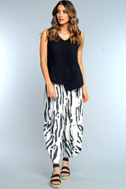 Khangura black and white funky pants. Unique wild print pants Easy pull-on, comfy pants made in USA by Khangura.  Online boutique for fun yet classy clothing for women.