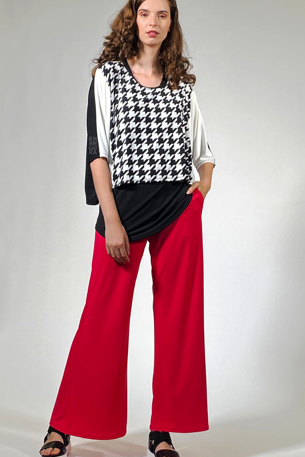 Beautiful outfit by Khangura. Khangura is Art to wear, comfy clothing brand based in California. Funky yet classy clothing outfit. Colorful pants mix and match with black and white artistic short top.