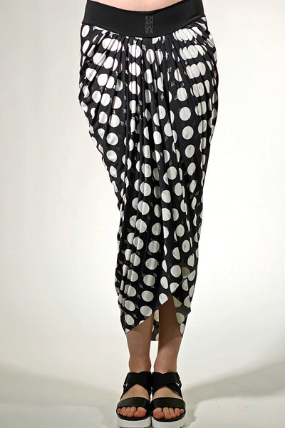 Khangura artfully pleated pull-on skirt. Perfect match for fashion over 40. Black white polka dot edgy yet elegant skirt. Comfy skirt made in USAby Khangura womens clothing boutique.