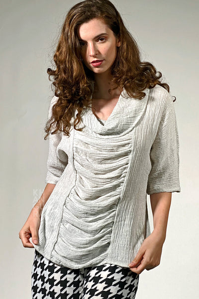 Khangura artistic crinkled high-end linen top. Cream white classic blouse with a twist. Comfy fashion top USA-Made. Artistic gathering short sleeve blouse in breathable crinkled designer fabric. Elegant high-quality designer top.