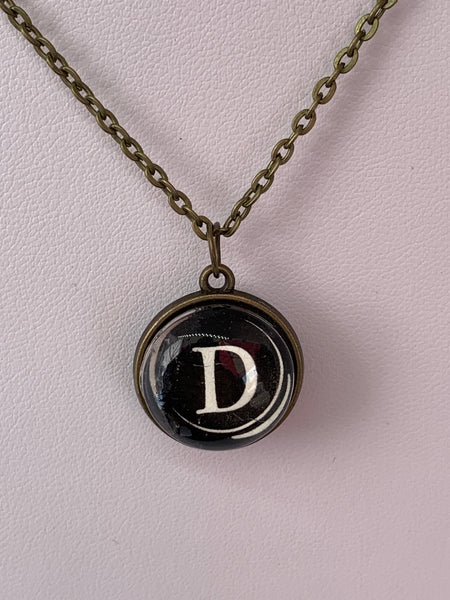 Double Sided Letter Necklace White Text on Black Background