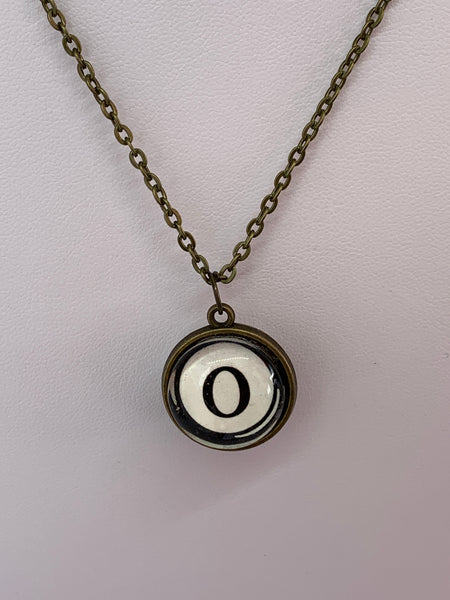 Double Sided Letter Necklace Black Text on White Background