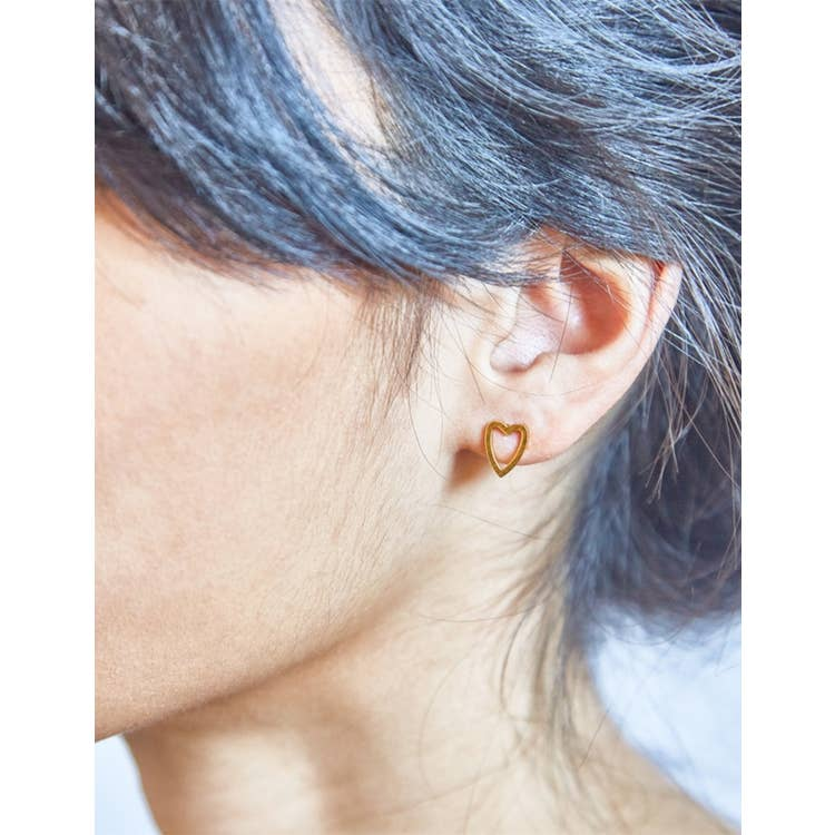 Admiral Row Gold Heart Outline Earring Studs on female model with dark hair