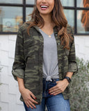 Gretta Camo Top on Model with Gray V-Neck front tied and basic jeans