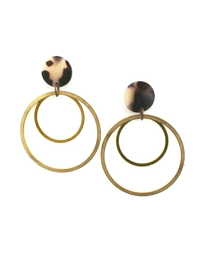 White tortoise circle earrings with double gold hoops hanging below them