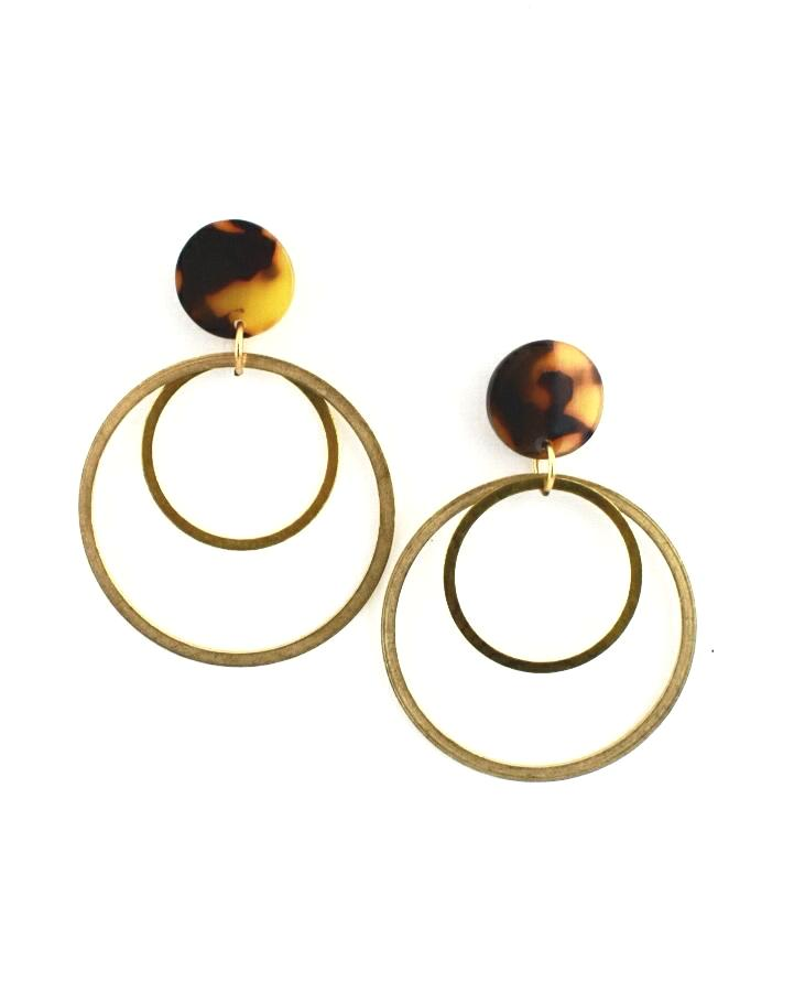 Tortoise circle earrings with double gold hoops hanging below them  Edit alt text