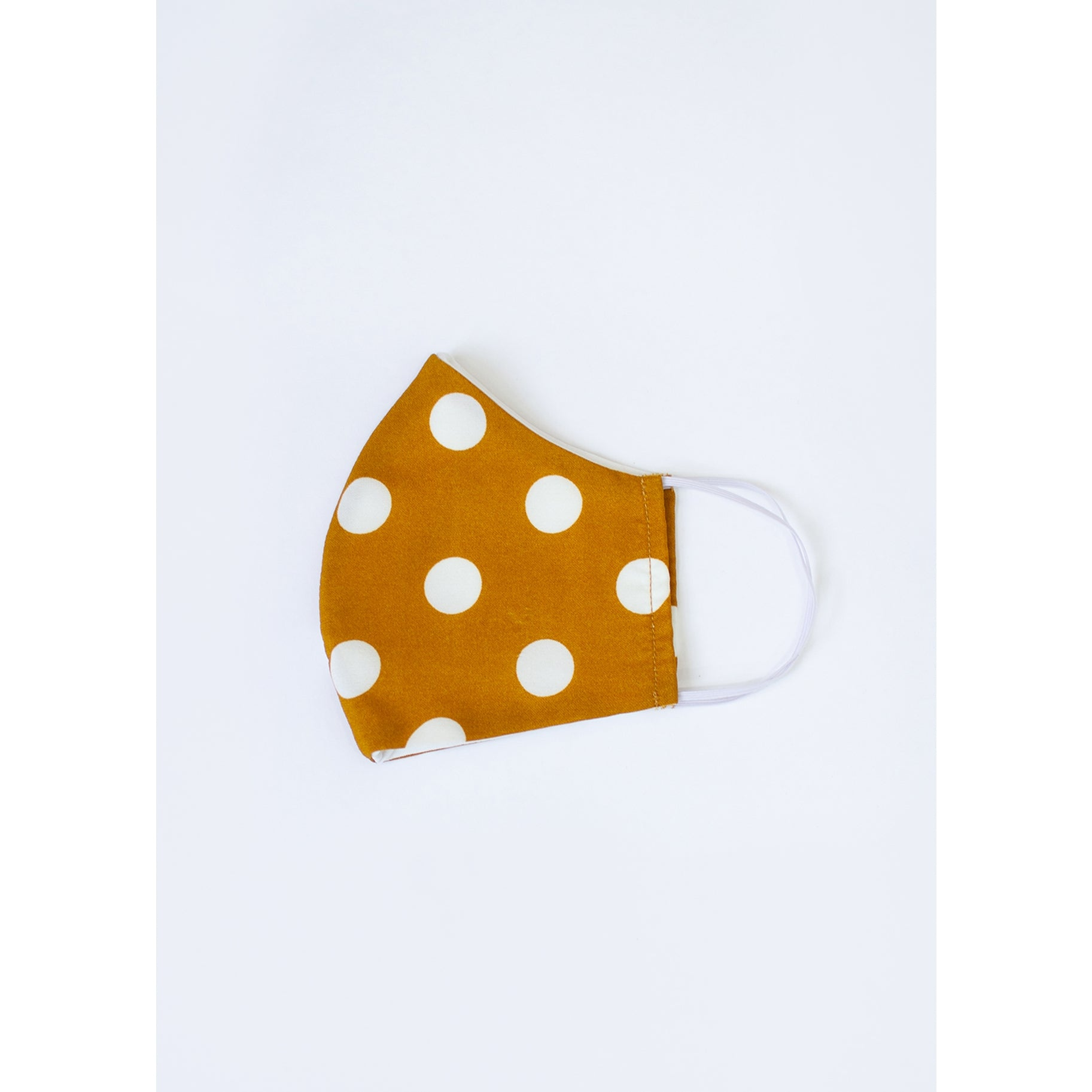 Folded in half mustard face mask with white polka dots