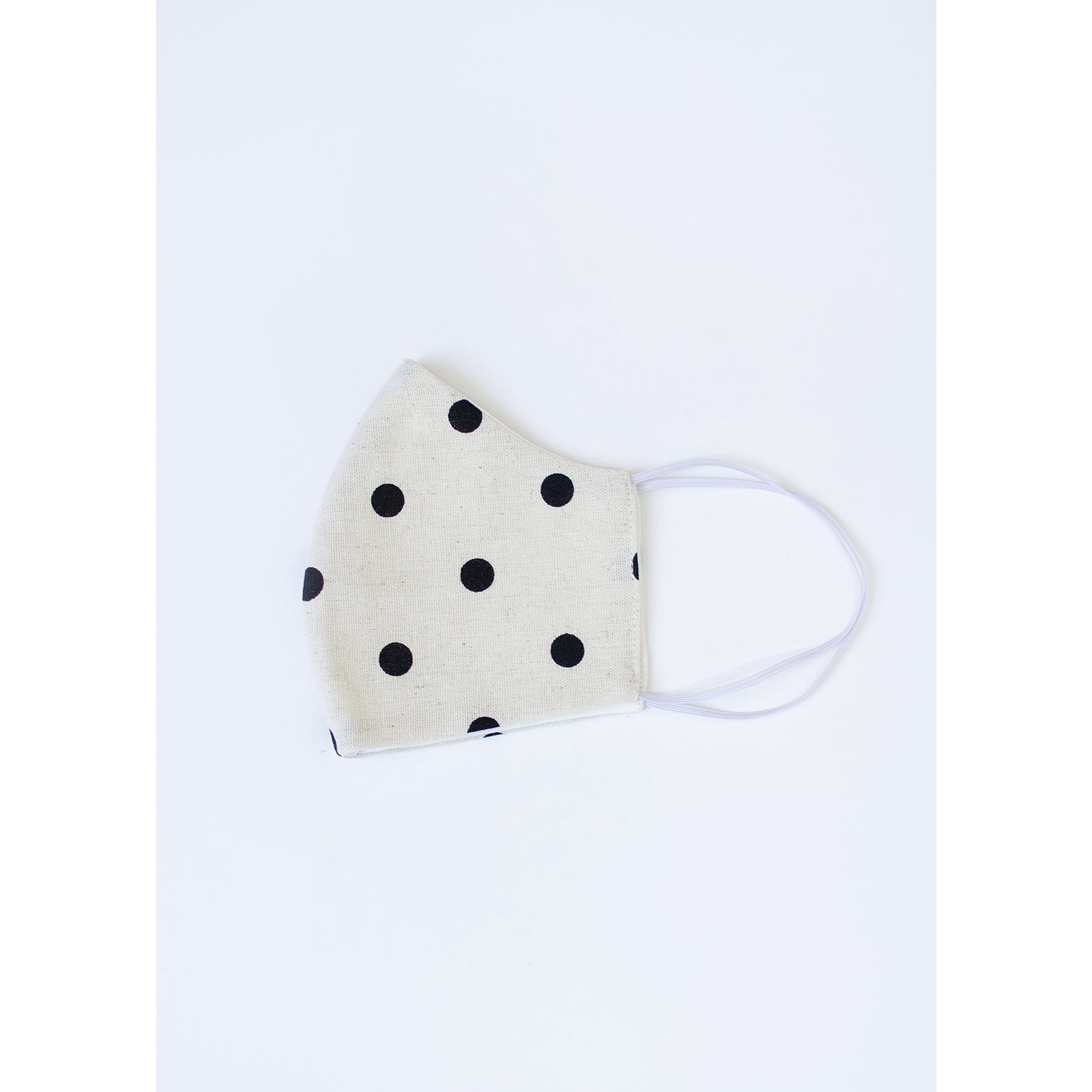 Folded in half white face mask with black polka dots