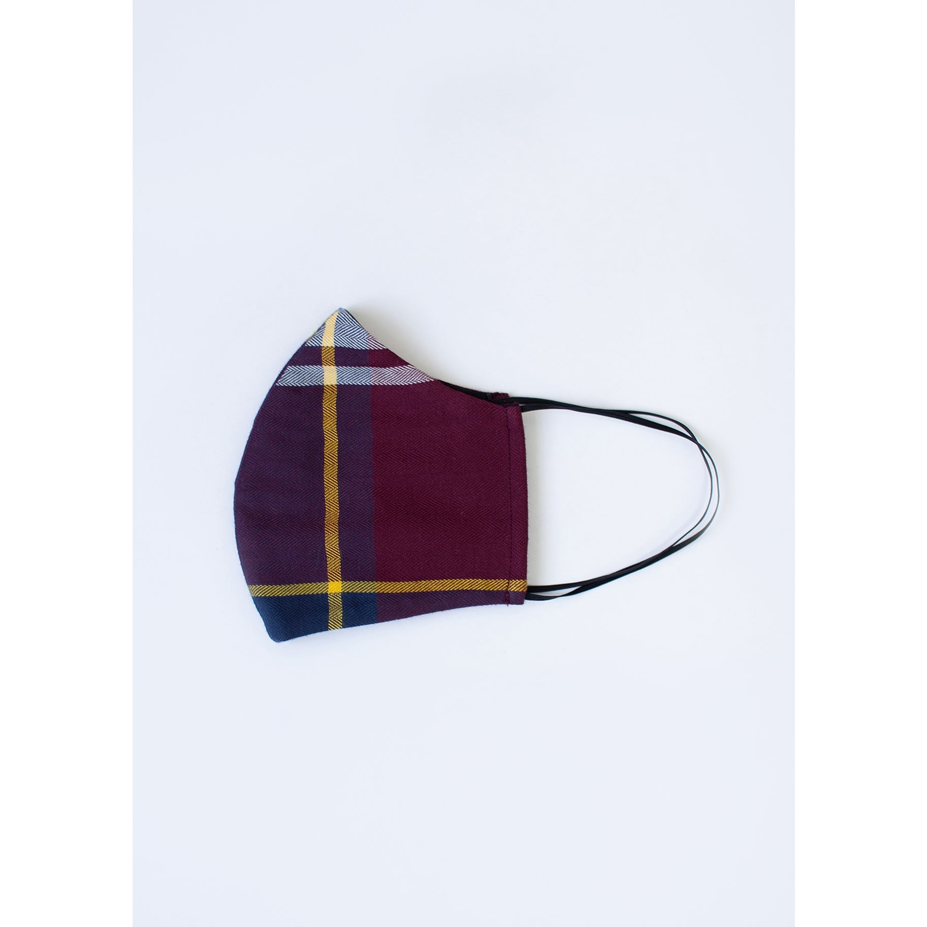 Folded in half burgundy purple gold white and navy plaid face mask