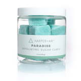 Clear jar with white cap and white harper + ari paradise label filled with teal sugar cubes