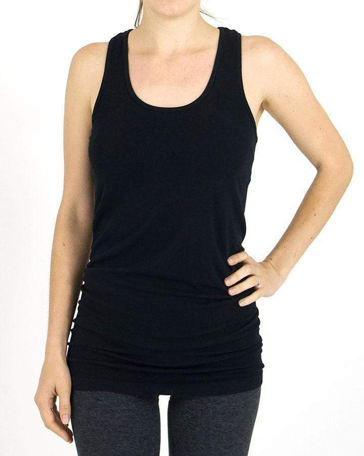 Model wearing the black racerback tank top paired with charcoal leggings against white backdrop