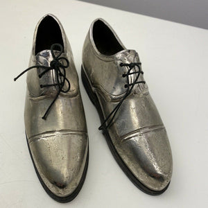 Silver coloured metal shoes