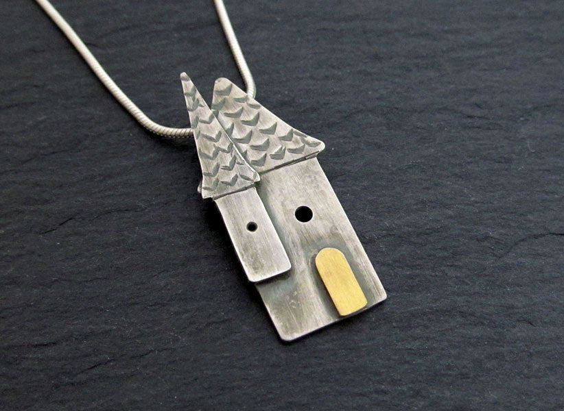 Silver house necklace with gold door