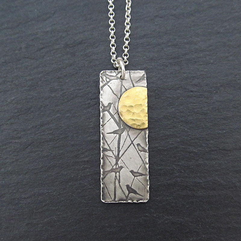 Bird and sun necklace