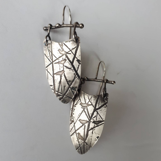 Oxidized metalwork earrings