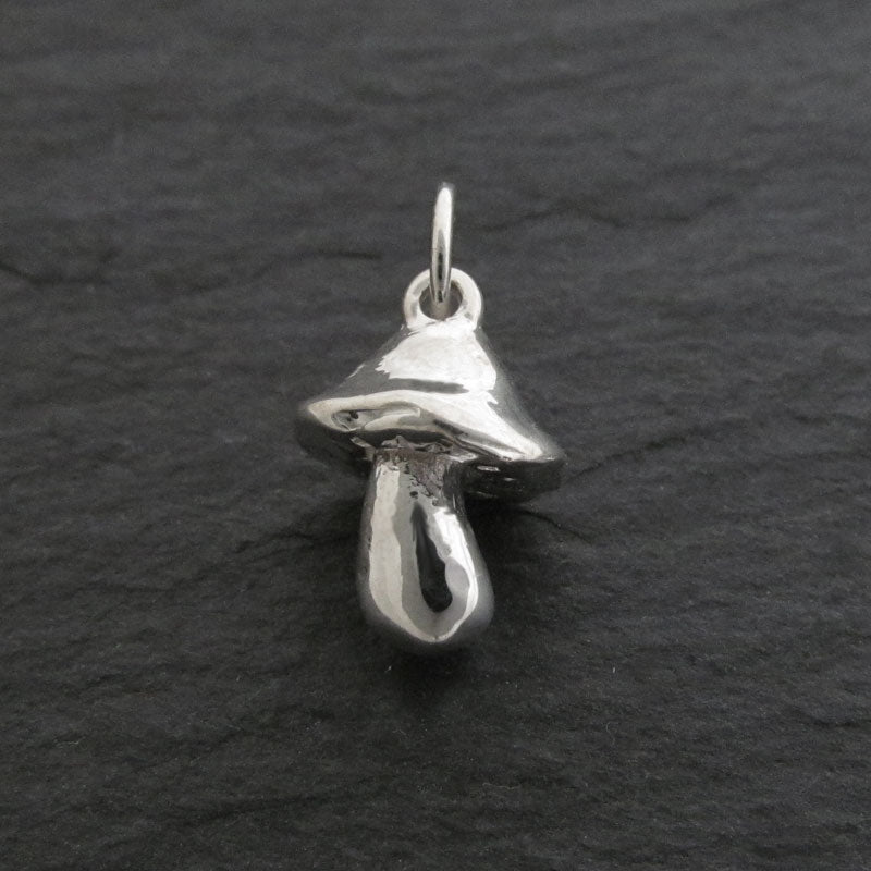 small sterling silver mushroom charm with polished finish