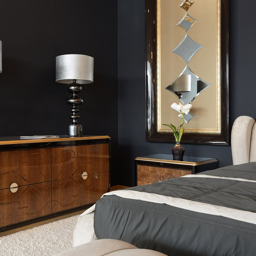 Black peel and stick removable paint and solid black wallpaper in apartment bedroom with gold tapestry and medium size bed- Pitch Black TemPaint