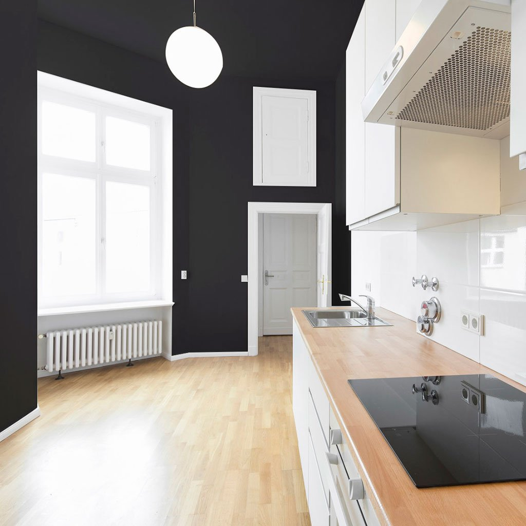 Black peel and stick removable paint and solid black wallpaper swank apartment kitchen with white cabinets- Pitch Black TemPaint