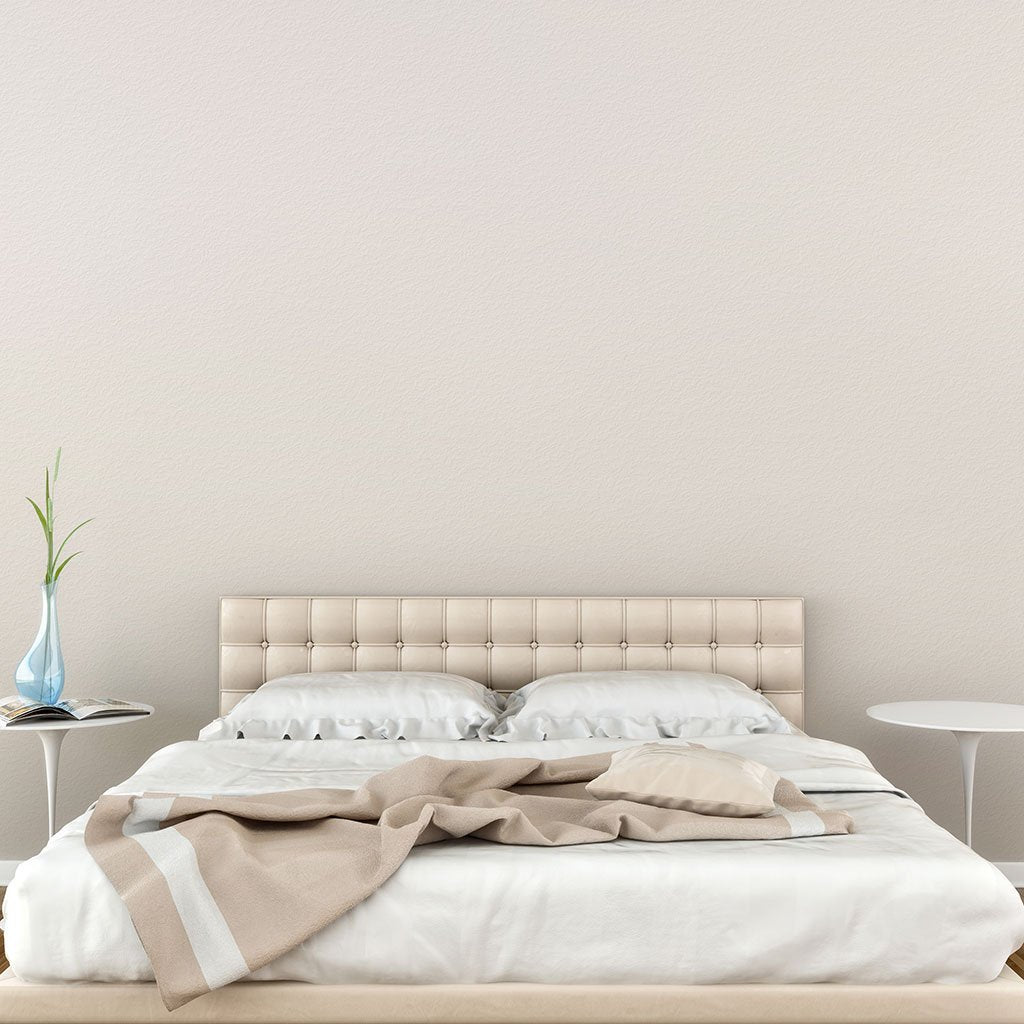 Eggshell peel and stick removable paint and solid eggshell color solid wall paper behind low bed - Parisian Eggshell TemPaint