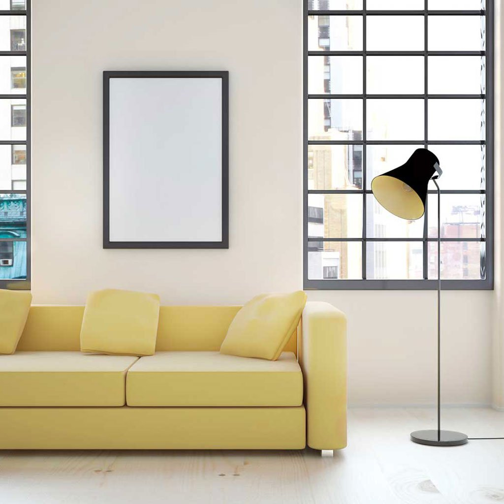 Eggshell peel and stick removable paint and solid eggshell color solid wall paper in urban apartment living room behind yellow couch and lamp - Parisian Eggshell TemPaint