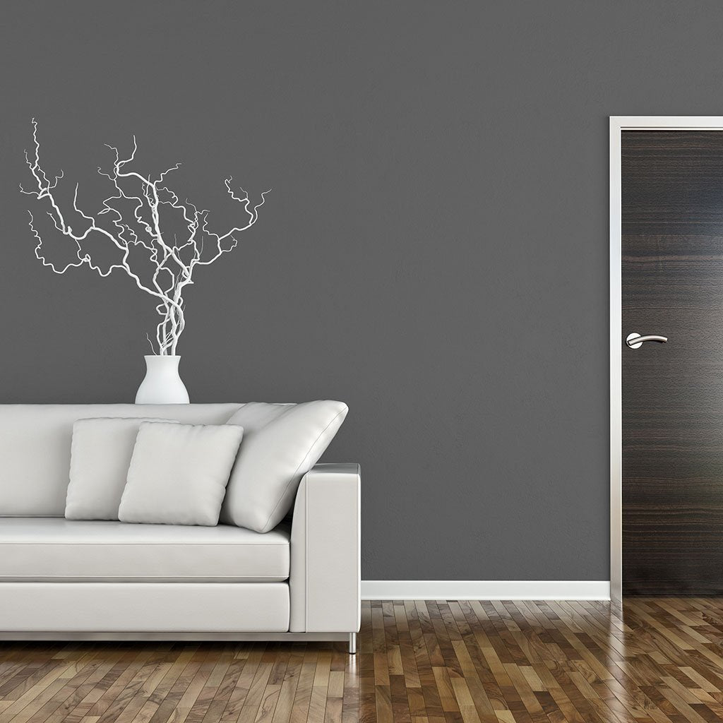 Gray peel and stick removable paint and solid gray wall paper behind white couch in living room - Portland Gray TemPaint
