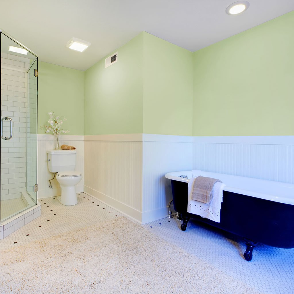 Light green peel and stick removable paint and solid light green wall paper in bright bathroom with white clawfoot tub  - Frosted Green TemPaint