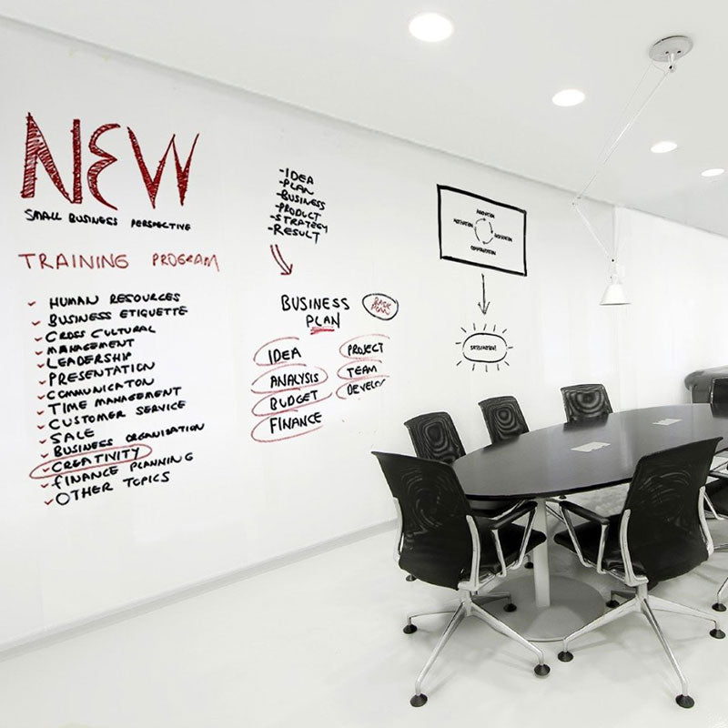 Large TemPaint dry erase board on wall of corporate office space with meeting table and chairs.