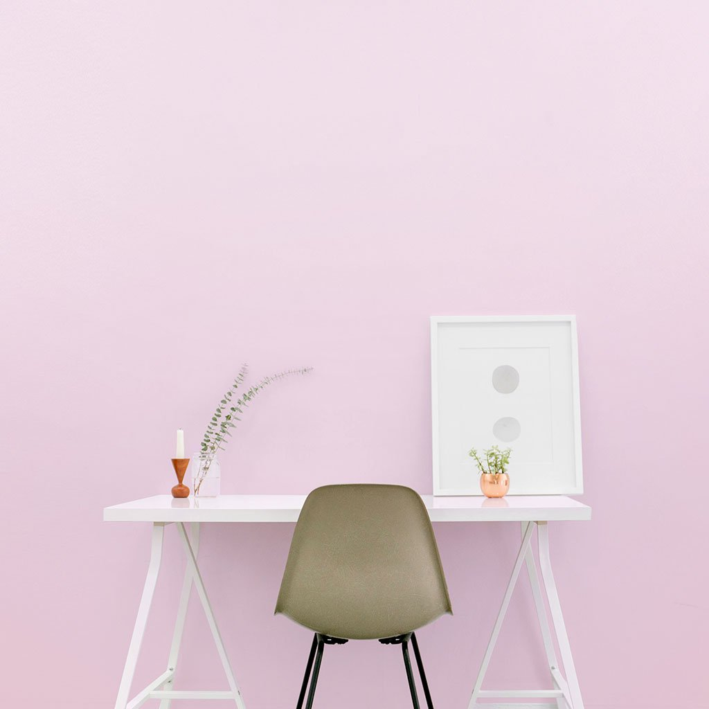 Pink peel and stick removable paint and solid orange wallpaper in bedroom with small desk and small office chair - Pensacola Pink TemPaint