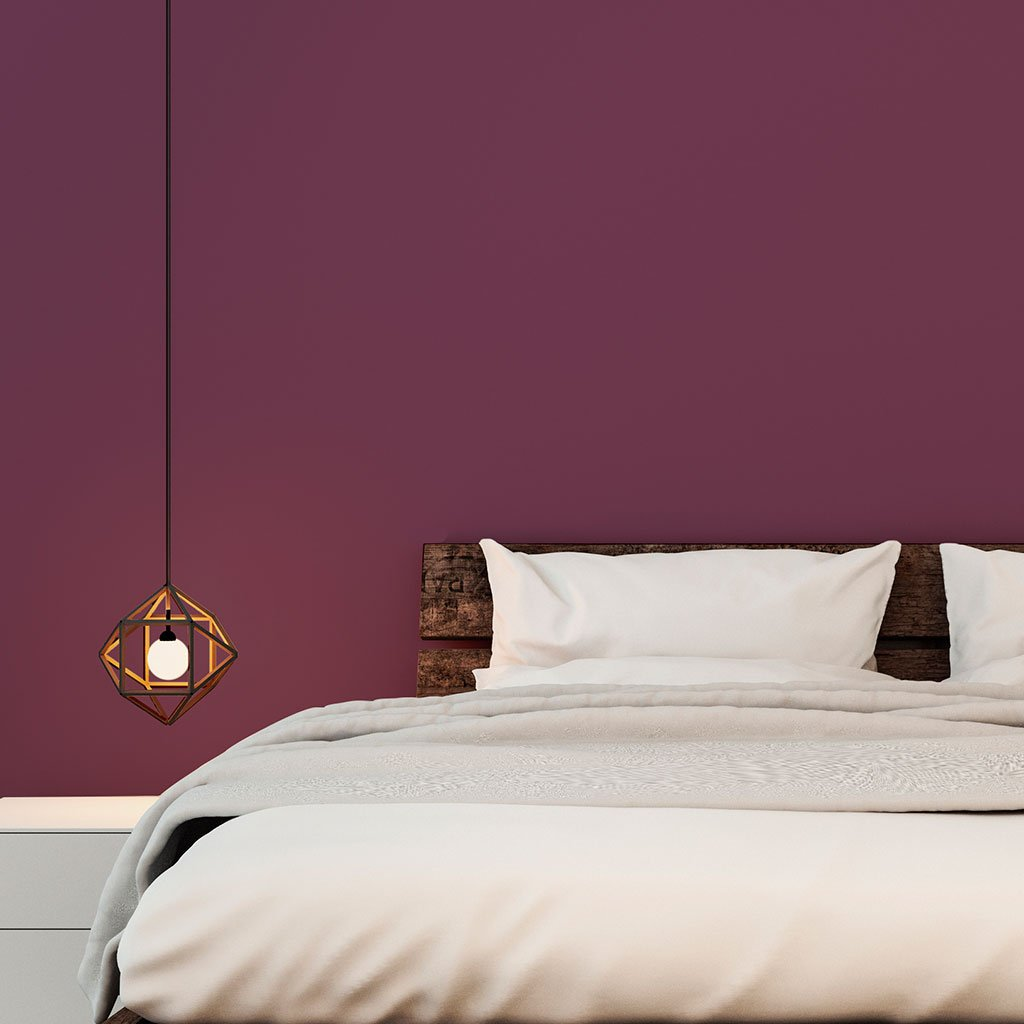 Purple peel and stick removable paint and solid purple wallpaper in bedroom with low bed and small pendant light - California Merlot TemPaint