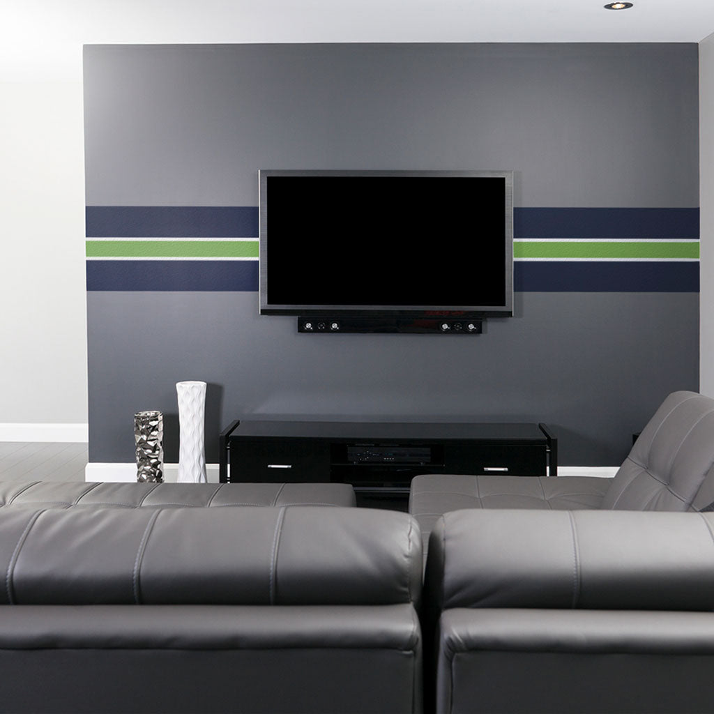 Tv mounted over seahawks and sounders decorations