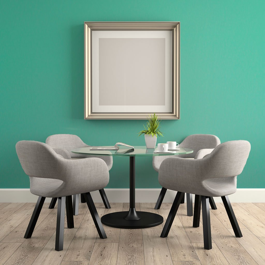 Teal peel and stick removable paint and solid teal wallpaper in a dining room with small table and four gray chairs - Caribbean Blue TemPaint