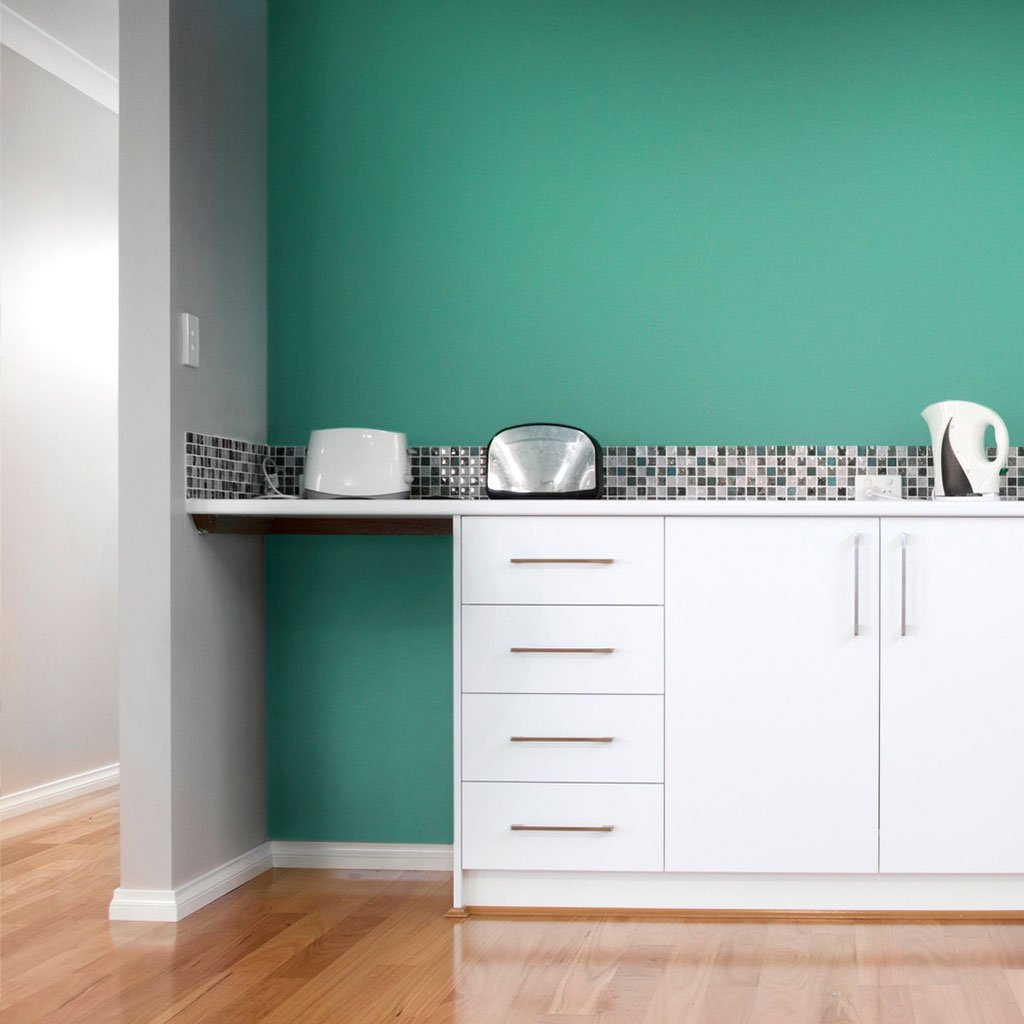 Teal peel and stick removable paint and solid teal wallpaper in apartment kitchen with white cabinets - Caribbean Blue TemPaint
