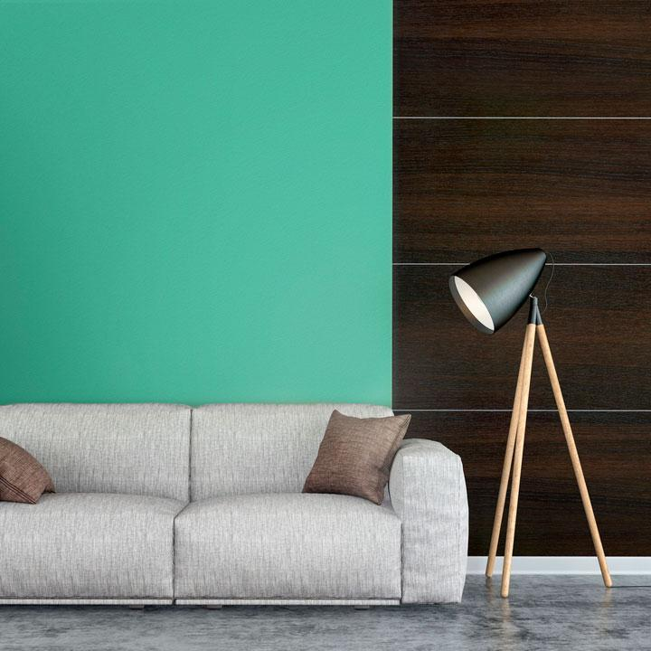 Teal peel and stick removable paint and solid teal wallpaper living room with brown wood panel wall - Caribbean Blue TemPaint