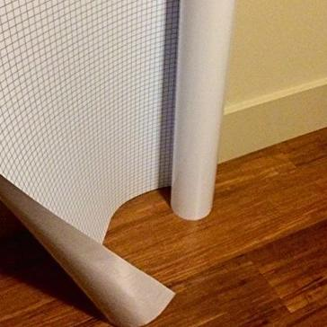 TemErase Peel and Stick Dry Erase Roll placed along wall for size comparison.