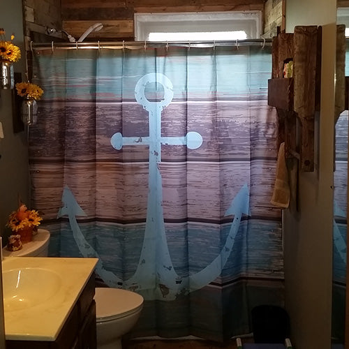 Shower curtain with sea anchor depicted on background of wooden sea ship flooring. Caribbean blue TemPaint on walls.