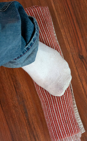 Stepping on your rolled up towel helps get even more water out