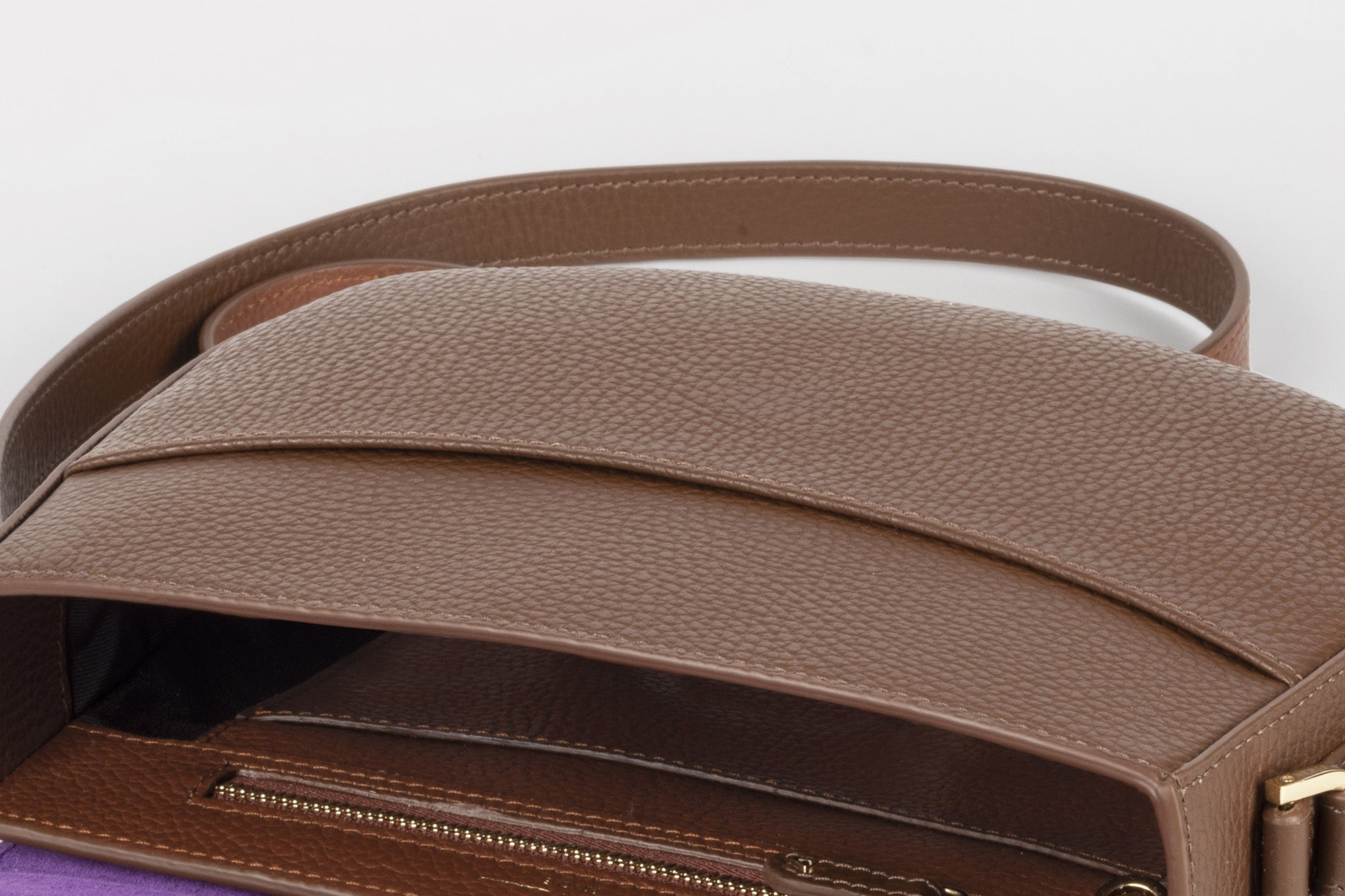 Close up of the top pocket of a Chocolate Brown Ana Crossbody bag, from Verlein