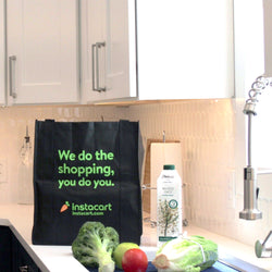 branded Instacart reusable grocery shopping bag with Elmhurst oat milk and vegetables