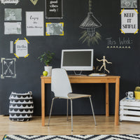 modern home office setup with large chalkboard