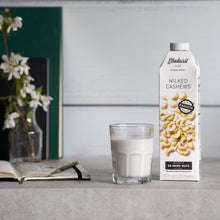 Load image into Gallery viewer, Barista Approved Cashew Milk, 32oz Carton with a glass full of cashew milk