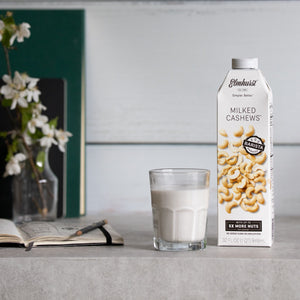 Barista Approved Cashew Milk, 32oz Carton with a glass full of cashew milk