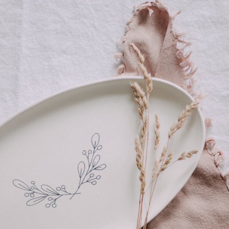 Handmade plate with botanical illustrations by Muddy Marvels Pottery and Natasshia Neary